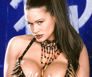 Older pornstar Tawny Peaks revealing massive fake tits and..
