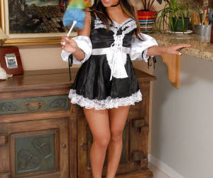 Adorable Asian maid Tinah shedding her uniform for nude..