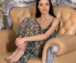18 year old brunette Alma slips off her long dress for..