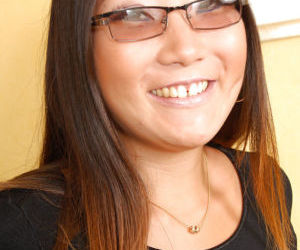 Close ups of glasses adorned Asian first timer Miki..