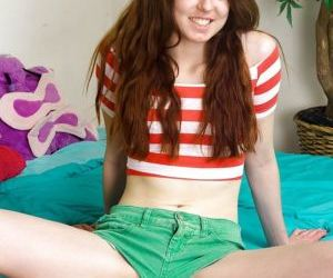 Teen redhead with a skinny body spreads her hairy pussy..