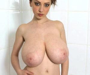 Solo model Merilyn Sakova wets her monster boobs and twat..