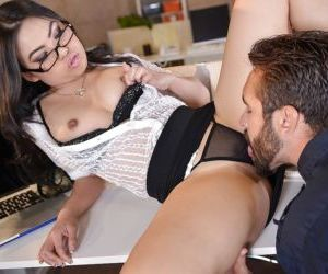 Glasses adorned Asian secretary Cindy Starfall having bald..