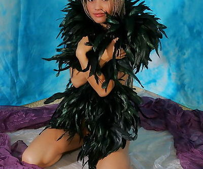 Long haired angel in black feather outfit