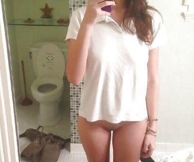 Bottomless teen selfie shows sweet little pussy