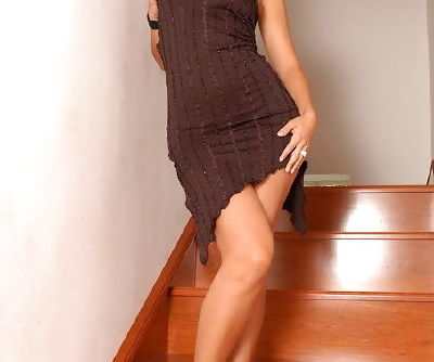 Long legged lady in a brown dress hangs out and opens her pussy lips