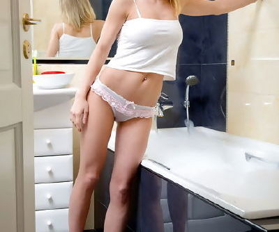 Teen perky tits get wet in the bathtub along with her fresh pussy